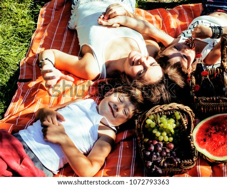 cute happy family on picnic laying on green grass mother and kids, warm summer  - Shutterstock ID 1072793363