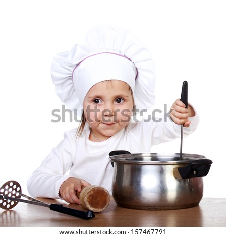 cute happy little baby cooking something