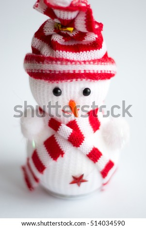 f7256518a85 Cute happy snowman in a red and white striped hat and scarf on a white  background