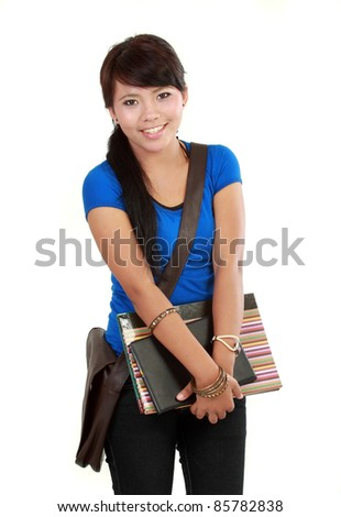 Cute happy student  holding open textbook, studio isolated, looking at copy space, youth lifestyle, education and back to school concept