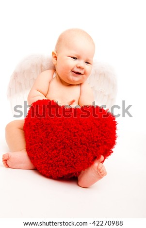 Cute happy valentine angel playing with red hearts