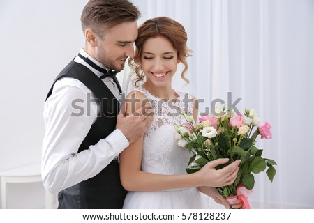 Cute happy wedding couple at home