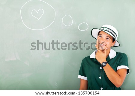 cute high school girl thinking about love in classroom