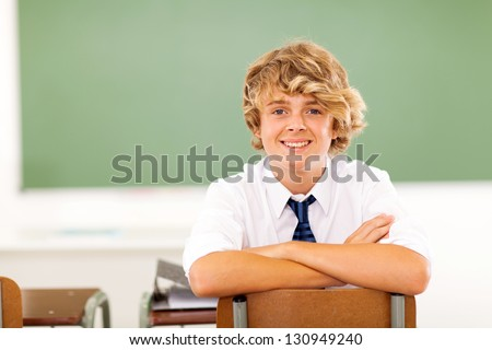 cute high school student sitting in classroom