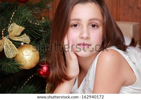 Cute home portrait of beautiful little girl as an angel over Christmas decoration on Holiday theme/Christmas - Cute little Angel