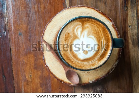 Cute Hot Latte Coffee on the wood, top view #293925083