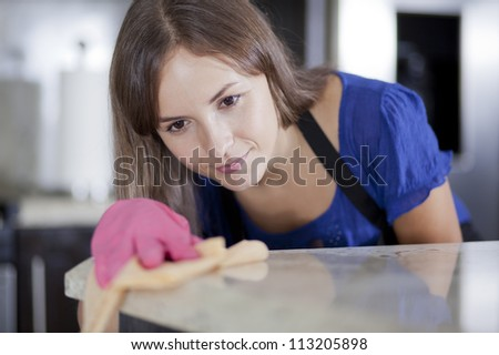 Cute housewife cleaning the kitchen