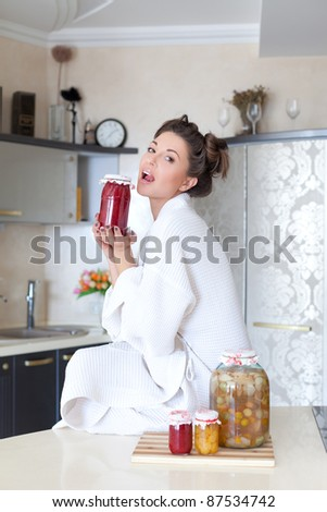 Cute housewife with fruit preserves