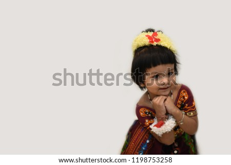 16f1bf125a Cute Indian baby girl dresses in traditional clothes and giving some  natural poses. #1198753258