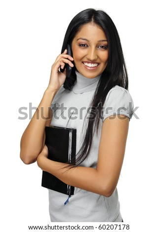 Cute Indian girl talks on her mobile phone
