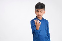 Cute indian little boy counting on finger