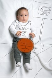 Cute infant baby boy playing basketball sketch