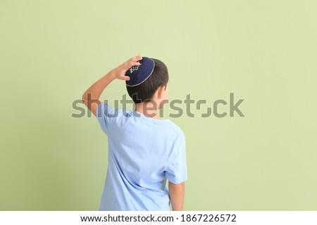 Cute Jewish boy on color background Stok fotoğraf ©