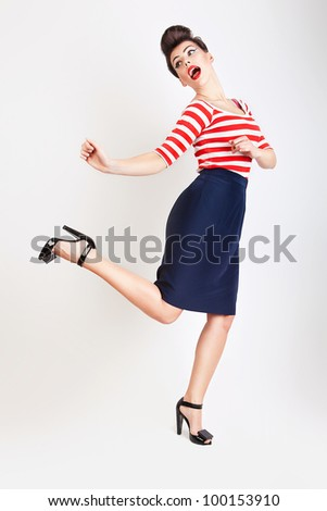 cute jumping woman in t-shirt and skirt - stock photo