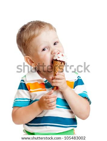 cute kid boy eating ice cream in studio isolated