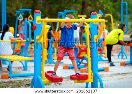 cute kid  boy exercising on...