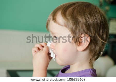 Cute kid cleaning his nose