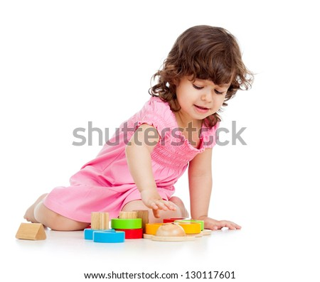 cute kid girl playing with colorful toys isolated on white background