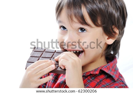 Cute kid isolated on white eating chocolate
