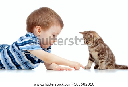 cute kid lying on floor and playing with cat pet