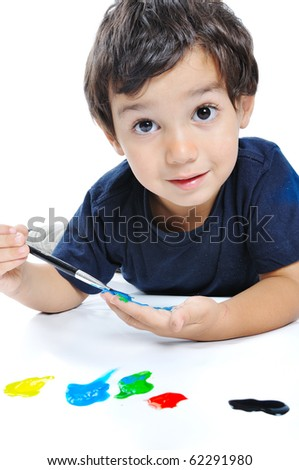 Cute kid playing with colors on white