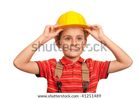 Cute kid putting on construction helmet, isolated on white background