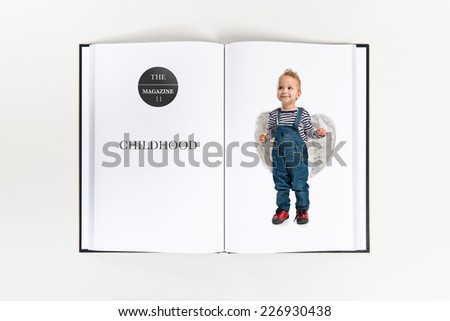 Cute kid with wings printed on book