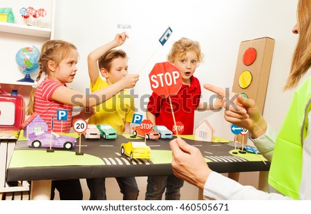 Cute kids having fun teaching traffic signs