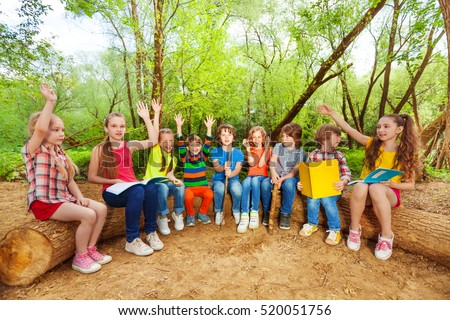 Cute kids reading books outdoor sitting on the log #520051756