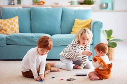 cute kids, siblings playing at home, elder brother doesn't let the sister to eat small toy particles, choking hazard