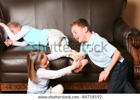 stock-photo-cute-kids-tickling-sister-s-feet-84718192.jpg