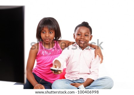 Cute kids watching TV, the image is in horizontal with copy space #100406998