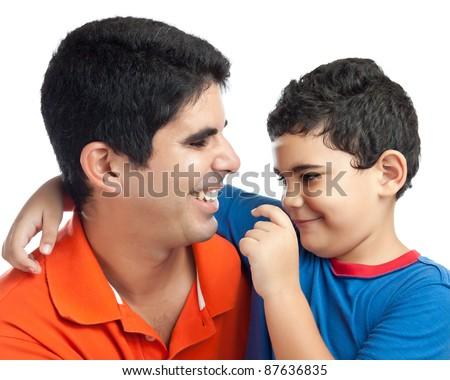 Cute latin boy hugging and playing with his father isolated on white