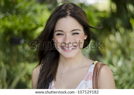 Cute latin woman buying plants at a nursery garden