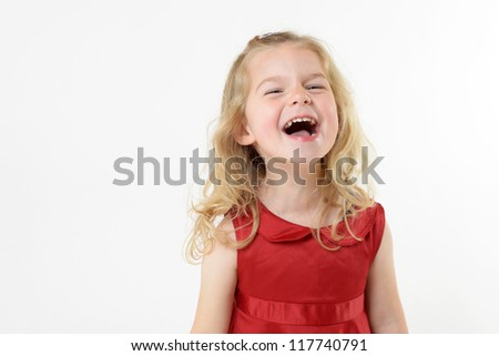 cute laughing girl in red dress
