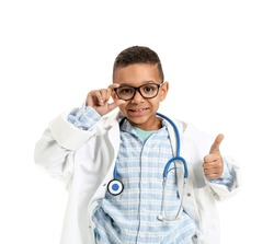 Cute little African-American doctor showing thumb-up on white background
