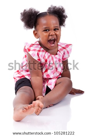Cute little african american girl laughing, isolated on white background