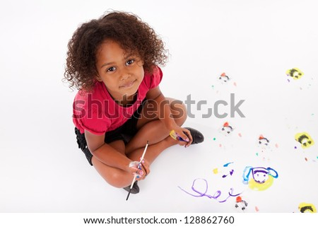 Cute Little African American girl painting on the floor - stock photo