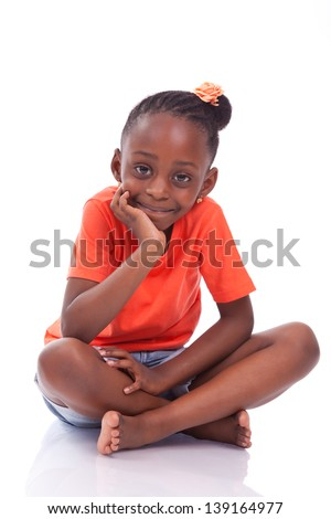 Cute little african american girl sitting on the floor - Black children , isolated on white background