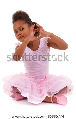 Cute little African Asian girl sitting on the floor,  isolated on white background - stock photo