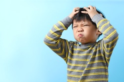 Cute Little Asian Boy Feel Strain, Angry, Bored, Isolated On Blue Background.