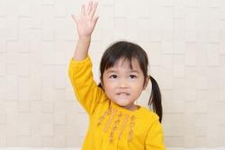 Cute little Asian girl smiling