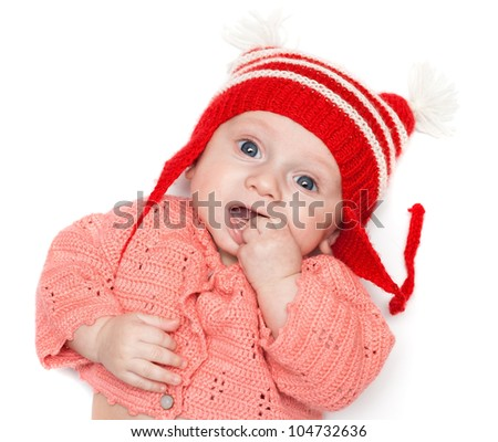 Cute little baby boy holding his hand in mouth (isolated)