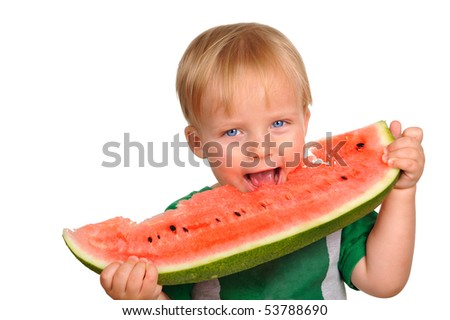 Cute little baby boy is having a juicy watermelon - stock photo
