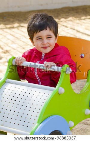 Cute little baby boy playing at park , smile