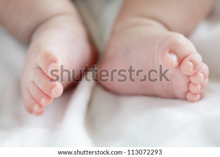 cute Little baby feet toe close up