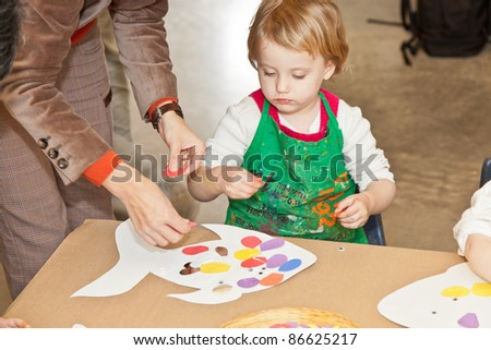 Cute little baby girl having fun painting at art class #86625217