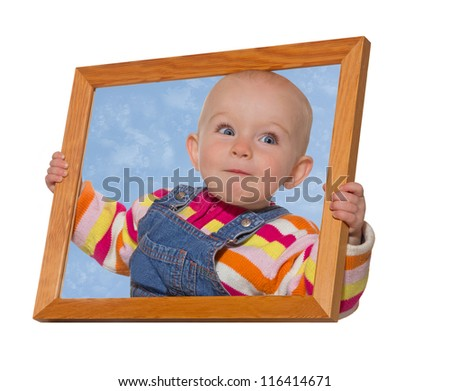 Cute little baby girl holding an empty wooden picture frame around her head with blue sky inside the surround isolated on white - stock photo