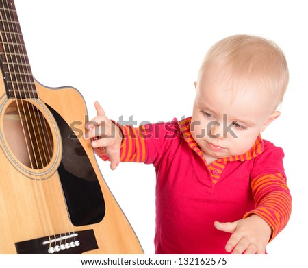 Cute little baby girl musician playing guitar isolated on white background