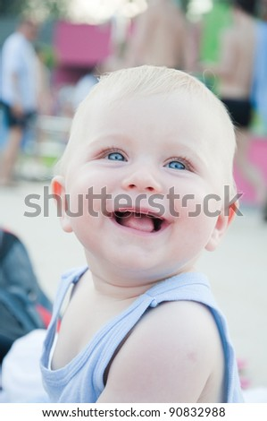 Cute little baby is playing on playground